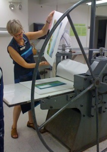 Ann Forbush at work with the Printing Press